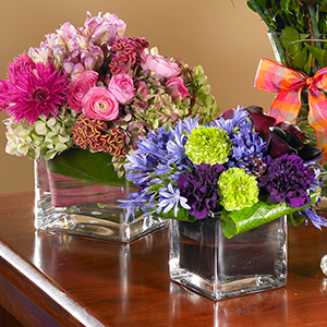 cube vases with pink and purple flowers