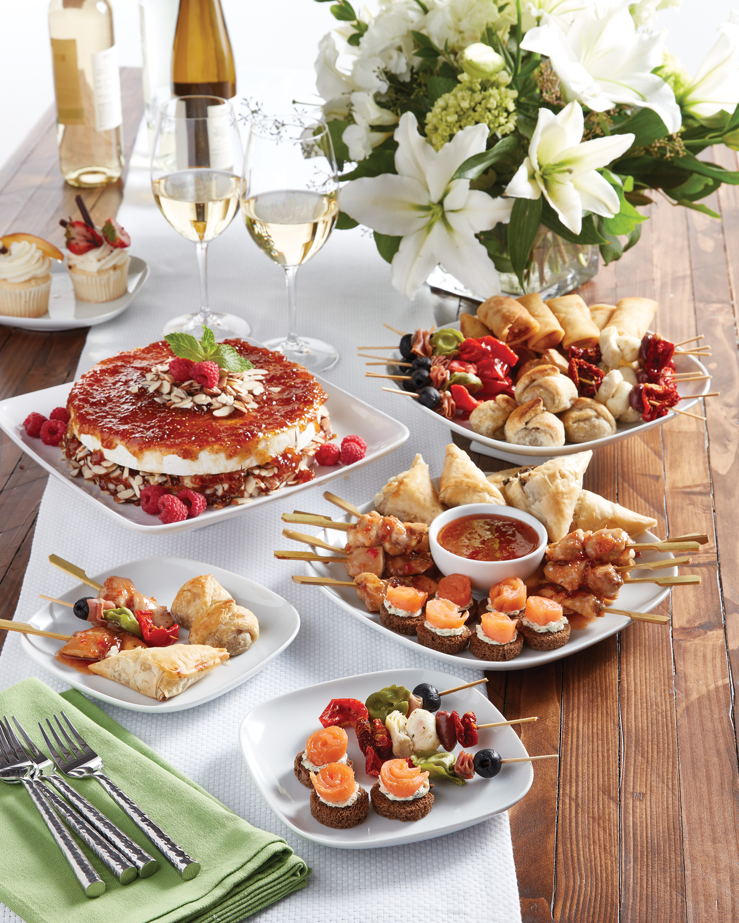 Entertaining with AJ's Fine Foods. A table with delicious lookng appetizers in a professionally catered setting.
