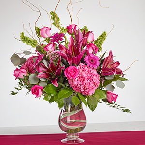 vase of hot pink lilies, roses, hydrangeas and daisy flowers