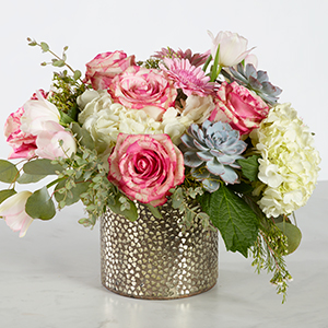 pink and white flowers in a hammered gold colored metal vase